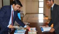 Ambassador of Afghanistan to Pakistan His Excellency Mr. Janan Mosazai on registration desk